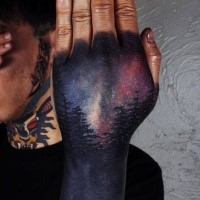 New school style colored hand tattoo of dark night forest