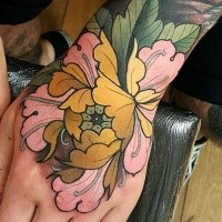 New school style colored hand tattoo of big flower