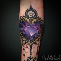 New school style colored heart shaped diamond tattoo on forearm with flower