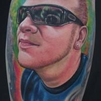 New school style colored leg tattoo of man in sun glasses portrait