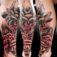 New school style colored leg tattoo of pirate wolf with skulls and roses