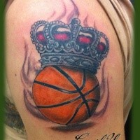 New school style colored shoulder tattoo of basketball with crown