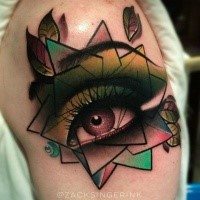 New school style colored shoulder tattoo of woman eye with figures