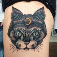 New school style colored thigh tattoo of cool cat stylized with moon symbol