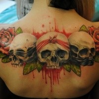 New school style colored upper back tattoo of skulls with roses