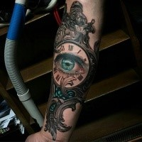 New school style colored vintage clock forearm tattoo stylized with blue eye