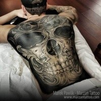 New school style colored whole back tattoo of human skull with ornaments