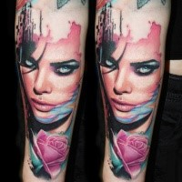 New school style colored woman portrait tattoo on forearm with pink rose