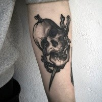 New school style detailed arm tattoo of chained human skull with dagger