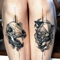 New school style half colored tattoo of animal skull and wolf head