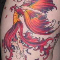 Nice fiery dancing fairy tattoo on thigh