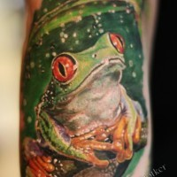 Nice green frog sitting in rain tattoo