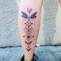 Nice looking arrow shaped black ink tattoo on leg stylized with various ornaments