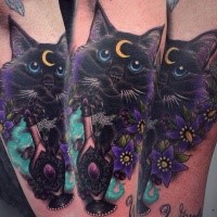 Nice looking colored arm tattoo of cat with flowers and moon