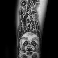 Nice natural looking arm tattoo of cute panda bear with bamboo