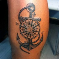 Nice painted detailed old roped anchor with compass tattoo on thigh