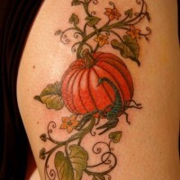 Nice plump naturally colored pumpkin shoulder tattoo with scorpion and tiny details