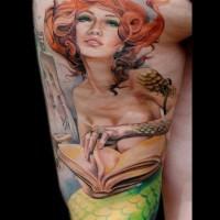 Nice redhead mermaid with book tattoo on thigh