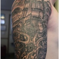 Octopus attack on a ship tattoo on half sleeve