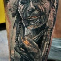 Old american indian smoking a pipe tattoo