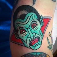 Old horror cartoon style unique colored vampire tattoo on arm