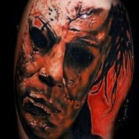 Old horror movie like black and white monster face tattoo on shoulder