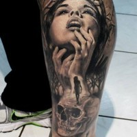 Old horror movie like black and white mystical painted woman with skulls tattoo on ankle