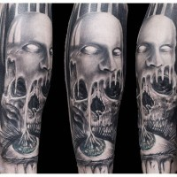 Old horror movie style black and white creepy skull with mask and eye tattoo on sleeve