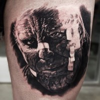 Old horror movie very detailed creepy monster portrait tattoo on thigh