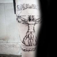 Tatuaggio del braccio di inchiostro nero dall'aspetto vecchio con l'iscrizione di un uomo vitruviano