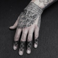 Old looking dot style hand tattoo stylized with crosses