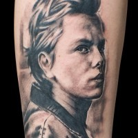 Old movie hero black and white realistic portrait tattoo on arm