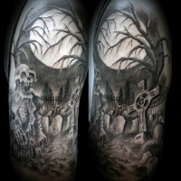 Old school black and white creepy cemetery with zombie tattoo on shoulder