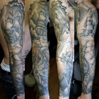Old school black and white nautical tattoo on sleeve