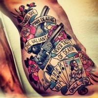 Old school gun and playing cards tattoo on ribs