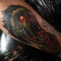 Old school multicolored forearm tattoo of creepy zombie