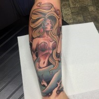 Old school painted forearm tattoo of seductive mermaid