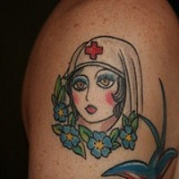 Old school shoulder tattoo with nurse and flowers