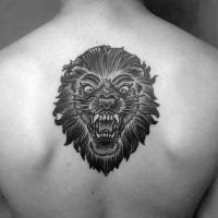 Old school style black ink upper back tattoo of demonic lion