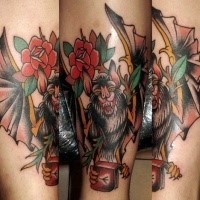 Old school style colored arm tattoo of vampire bat and flowers