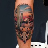 Old school style colored arm tattoo of desert with cactus and animal skull