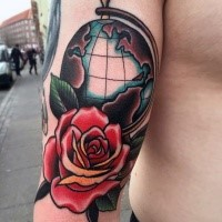 Old school style colored arm tattoo of big globe with rose