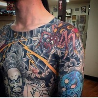 Old school style colored fantasy spider tattoo with various Asian demons