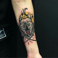 Old school style colored forearm tattoo of angry wolf with crossed weapons