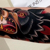 Old school style colored furious crazy wolf's head tattoo on arm