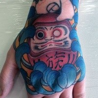 Old school style colored hand tattoo of daruma doll with flower