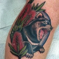Old school style colored leg tattoo of roaring animal with flowers