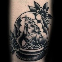 Old school style colored magical orb with ship and flowers tattoo