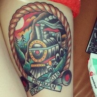 Old school style colored memorial thigh tattoo of train with lettering