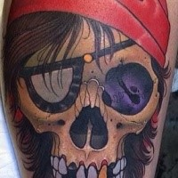 Old school style colored pirate skull tattoo on leg